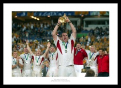 England 2003 Rugby World Photo - Martin Johnson Lifts the Trophy